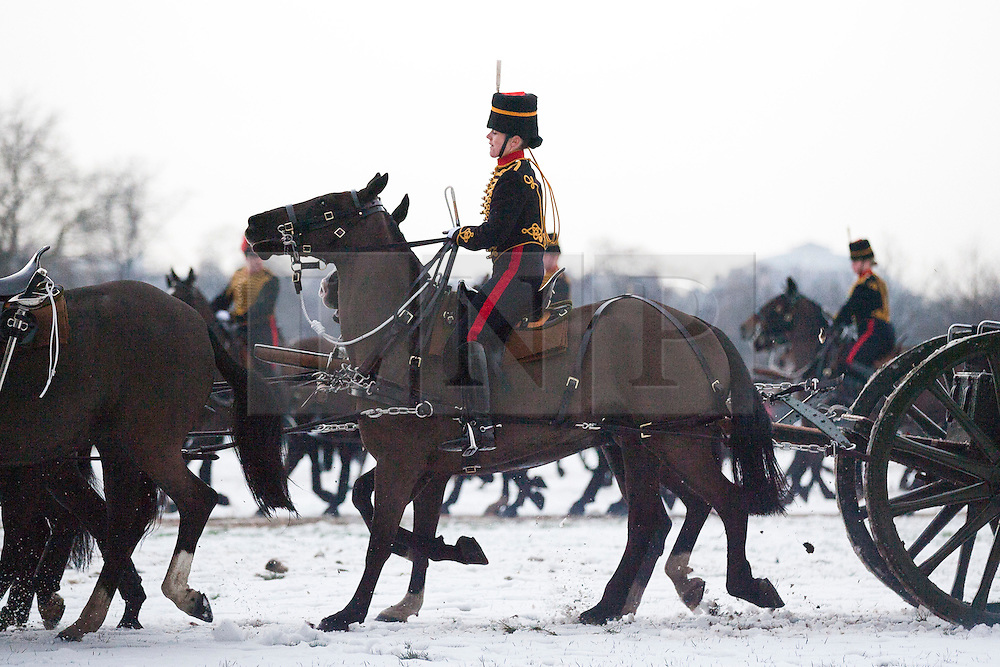 © Licensed to London News Pictures. 06/02/2012. LONDON, UK. Riders and guns of the Kings Troop Royal Horse Artillery canter through Hyde Park after firing a 41 gun salute. Gunners of the Kings Troop, based at St John's Wood since 1947, today (06/02/12) left their barracks for the last time to fire their guns in Hyde Park, the soldiers will move tomorrow to their new home in Woolwich. Photo credit: Matt Cetti-Roberts/LNP