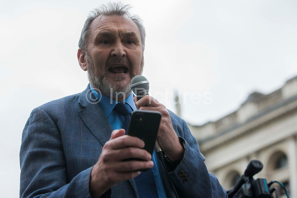 Kevin Courtney, Joint General Secretary of the National Education Union NEU, addresses thousands of people attending an emergency rally in solidarity with the Palestinian people organised outside Downing Street by Palestine Solidarity Campaign, Friends of Al Aqsa, Stop The War Coalition and Palestinian Forum in Britain on 11th May 2021 in London, United Kingdom. The rally took place in protest against Israeli air raids on Gaza, the deployment of Israeli forces against worshippers at the Al-Aqsa mosque during Ramadan and attempts to forcibly displace Palestinian families from the Sheikh Jarrah neighbourhood of East Jerusalem.
