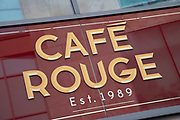Sign for the food and restaurant brand Cafe Rouge in Birmingham, United Kingdom.