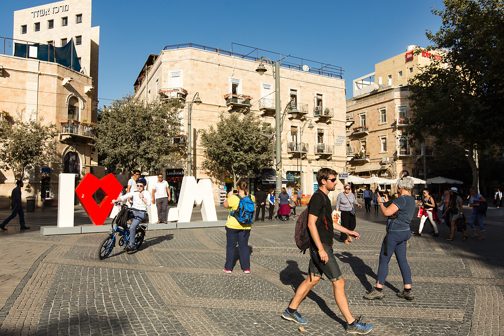 People are seen in Zion Square, on Jaffa (Yaffo) Street in Jerusalem, Israel, on October 1, 2017.