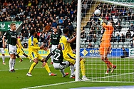 Matt Macey (1) of Plymouth Argyle makes a save from Jake Jervis (10) of AFC Wimbledon during the EFL Sky Bet League 1 match between Plymouth Argyle and AFC Wimbledon at Home Park, Plymouth, England on 6 October 2018.
