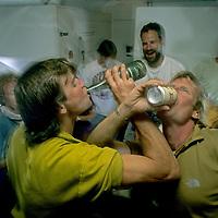 ANTARCTICA, Queen Maud Land Expedition members celebrating departure to Antarctica. (Alex Lowe & Conrad Anker fgnd.) (MR)