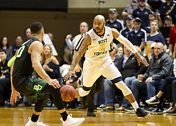 Jan 9, 2018; Morgantown, WV, USA; West Virginia Mountaineers guard Jevon Carter (2) dribbles the ball up the floor during the second half against the Baylor Bears at WVU Coliseum. Mandatory Credit: Ben Queen-USA TODAY Sports