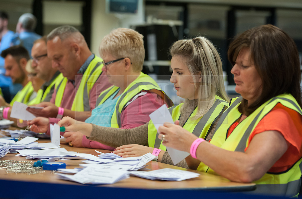 © Licensed to London News Pictures.23/06/2016. Bristol, UK.  EU Referendum 2016; the ballot papers are counted from the Bristol City Council area ballots in the EU Referendum at Parkview Office Campus in Whitchurch, Bristol. A false fire alarm interrupted the verification of ballot papers as everyone had to briefly evacuate the building before the all clear was given. Photo credit : Simon Chapman/LNP