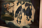 London, UK. Friday 23rd November 2012. Christies auction house showcasing memorabilia from every decade of the past century of popular culture from the industries of film and music. Walt Disney Studios Pinocchio, 1940. Original concept painting by Gustaf Tenggren of Pinocchio trapped in a birdcage with the shadows of other marionettes hanging by their strings, black ink and watercolour on heavyweight paper.