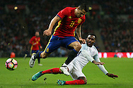 Danny Rose of England slides in to stop Vitolo of Spain. England v Spain, Football international friendly at Wembley Stadium in London on Tuesday 15th November 2016.<br /> pic by John Patrick Fletcher, Andrew Orchard sports photography.