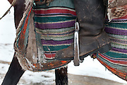 Detail of horseman's boots, horse cover and stirrups. .From Kher Metek to Langar...Trekking back down from the Little Pamir, with yak caravan, over the frozen Wakhan river.