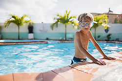 Boy with diving mask in the pool, Mauritius