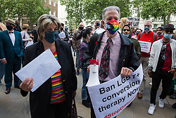 Jayne Ozanne of the Ban Conversion Therapy Coalition (l) and veteran LGBT+ and human rights campaigner Peter Tatchell (r) prepare to hand in a petition signed by 7,500 people at the Cabinet Office and Government Equalities Office calling on the government to fulfil a promise it made in July 2018 to ban LGBT+ conversion therapy on 23rd June 2021 in London, United Kingdom. LGBT+ conversion treatments, which have been linked to anxiety, depression and self-harm, have been condemned by major UK medical, psychological and counselling organisations.