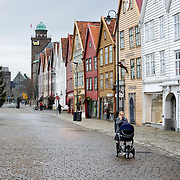 Noorwegen Bergen 30 december 2008 20081230 Foto: David Rozing .Havenstad Bergen, unesco world heritage site Bryggen  .Bryggen is de kade van de oude haven van de hanze stad Bergen. Rond de 13e eeuw werd Bergen een van de hanzesteden. Hierdoor ontstond veel handel met andere landen. Het centrum hiervan was de kade van de haven. De naam hiervoor is Bryggen. .In de 14e eeuw stonden hier zo'n 30 huizen die gedeeld werden door diverse handelsfirma's. De huizen zijn diverse keren afgebrandt en opnieuw opgebouwd. Sinds 1980 staan 58 houten gebouwen op de Unesco World Heritage lijst. .The city of Bergen, unesco world heritage site Bryggen .Bryggen, the old wharf of Bergen, is a reminder of the town's importance as part of the Hanseatic League's trading empire from the 14th to the mid-16th century. Many fires, the last in 1955, have ravaged the characteristic wooden houses of Bryggen. Its rebuilding has traditionally followed old patterns and methods, thus leaving its main structure preserved, which is a relic of an ancient wooden urban structure once common in Northern Europe. Today, some 62 buildings remain of this former townscape...Foto: David Rozing
