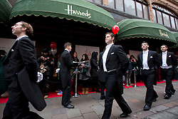 © Licensed to London News Pictures. 26/12/2013. London, UK. Actors dressed as butlers Shoppers entertain shoppers queueing for the start of the world famous Harrods department store Boxing Day sale in London today (26/12/2013). Photo credit: Matt Cetti-Roberts/LNP
