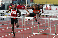 Super 8 athletics at the Cardiff International Stadium on Wed 10th June 2009. Callum Priestley of Birmingham (r) on his way to winning the mens 110m hurdles race.