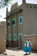 A two story house in the mud-walled W. African city of Djenne, Mali. Material World Project.