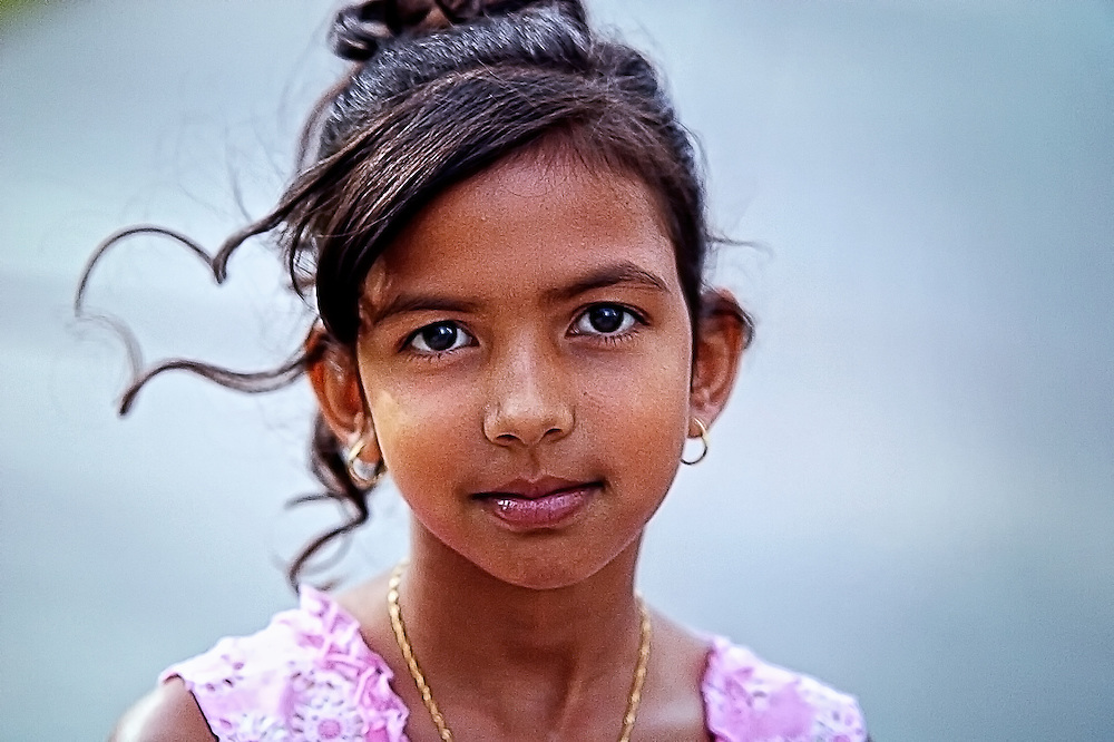 Portrait of East Indian girl in pink dress.