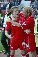 Photo. Andrew Unwin<br /> Middlesbrough v Leeds, Barclaycard Premier league, Riverside Stadium, Middlesbrough 30/08/2003.<br /> Middlesbrough's Juninho (l) celebrates scoring his team's second goal with new signing Gaizka Mendieta (r).