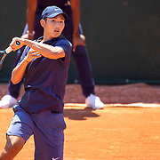 PARIS, FRANCE June 10. Juncheng Shang of China in action against Sean Cuenin of France in the quarter finals of the Junior Singles competition at the 2021 French Open Tennis Tournament at Roland Garros on June 10th 2021 in Paris, France. (Photo by Tim Clayton/Corbis via Getty Images)