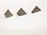 three gables of the snowed-in Paradise Inn at Mount Rainier National Park, Washington, USA gables of the snowed-in Paradise Inn during a snowstorm at Mount Rainier National Park, Washington, USA