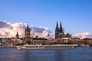 Germany, Cologne, view over the river Rhine to the old part of the town with the steeple of the historic town hall, the romanesque church Gross St. Martin and the gothic cathedral.<br /> <br /> Deutschland, Koeln, Blick ueber den Rhein zur Altstadt mit dem Rathausturm, der Kirche Gross St. Martin und dem Dom.