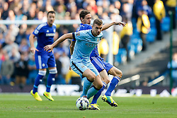 Edin Dzeko of Manchester City is challenged by Nemanja Matic of Chelsea - Photo mandatory by-line: Rogan Thomson/JMP - 07966 386802 - 21/08/2014 - SPORT - FOOTBALL - Manchester, England - Etihad Stadium - Manchester City v Chelsea FC - Barclays Premier League.