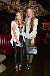 Left to right, ROSIE FORTESCUE and HUM FLEMING at a party hosted by Christian Lacroix partnered with Supa Model Management to celebrate London Men's Collections January 2015, held at the Rumpus Room, the roof top bar at the top of the Mondrian London, 20 Upper Ground, London SE1 on 12th January 2015.
