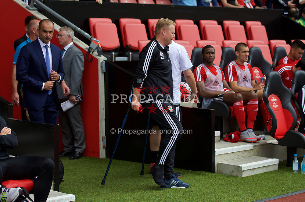 SOUTHAMPTON, ENGLAND - Saturday, August 15, 2015: Southampton's manager Ronald Koeman on crutches after an operation for a ruptured Achillies during the FA Premier League match at St Mary's Stadium. (Pic by David Rawcliffe/Propaganda)