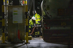 © Licensed to London News Pictures. 05/10/2021. Workers fill a fuel tanker at Buncefield oil depot in Hemel Hempstead, Hertfordshire. Military personnel have started helping with driver shortages  following more than a week of long queues and closures at petrol stations. Photo credit: Ben Cawthra/LNP