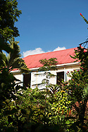 John Criswick's colonial style house overlooking his tropical garden at the St. Rose Nursery, La Mode, St. George's, Grenada
