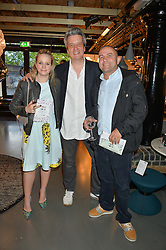 Left to right, JUSTIN & CATRIONA BLAMPIED and CHRIS COLLINS at Fork to Fork - a Fundraising Feast to support The Open Air Classroom Project held at The Dock Kitchen, Portobello Docks, 342-344 Ladbroke Grove, London on 19th May 2015.