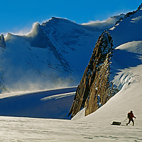 Mountaineers ski below the wind-whipped Filchner Mountains in Queen Maud Land.