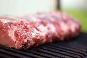 Raw Meat on an outdoor grill