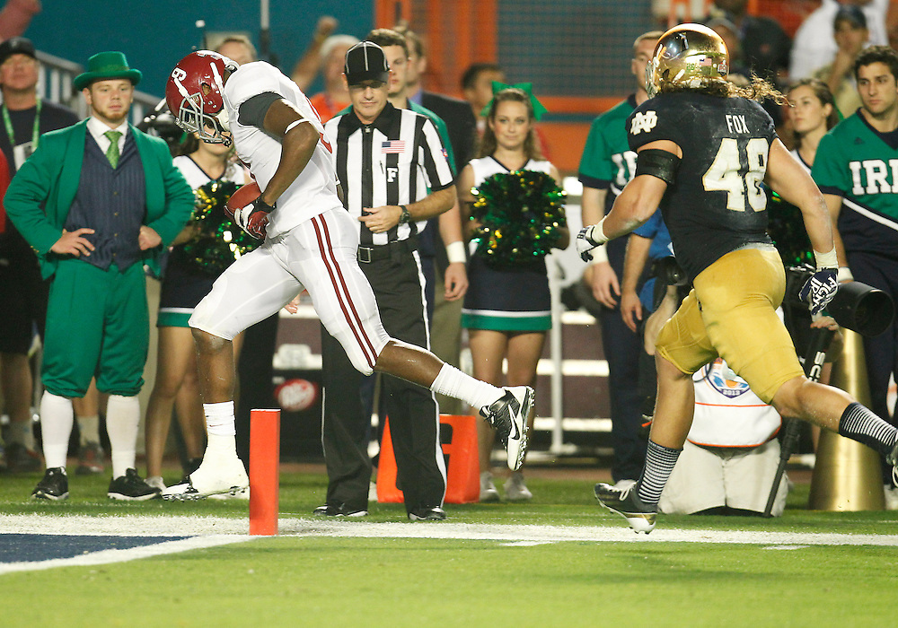 January 7, 2013:  Alabama wide receiver Amari Cooper (9) scores touchdown during the Discover BCS National Championship between the Alabama Crimson Tide and the Notre Dame Fighting Irish at Sun Life Stadium in Miami Gardens, Florida.  Alabama defeated Notre Dame 42-14.