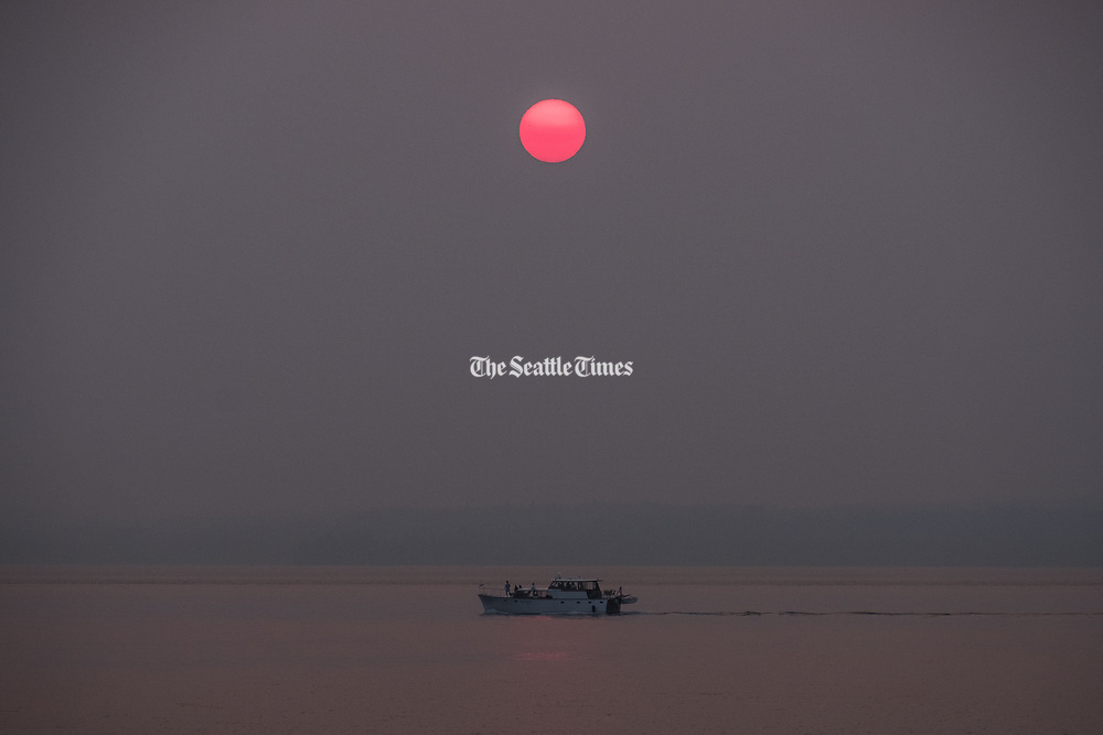 Blame Canada for the wildfire haze in Seattle? Canadians say no way. (Dean Rutz / The Seattle Times)