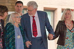 London, June 27th 2014. With the jury still to reach a verdict on the 12 charges of indecent assault against girls aged between 7 and 19, at the end of their 7th day in retirement, Rolf Harris, who denies the charges, leaves court with his wife Alwen, left, and daughter Bindi.