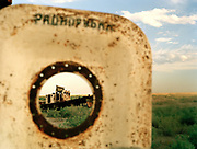 Abandoned boats right near Moynaq town, former fishing port on the Aral Sea, now 180km from shore. Uzbeks people scraps the boat for metal.<br /> Since 1960's, The Aral Sea has been drained of 75% of its water, because of the diversion of upstream rivers that are used for cotton plantation. It use to be the 4th largest lake in the world. The resulting desertification is accelerating dramatically global warming. High salinity means no more fish. Anthrax and rabbies test were also done in a former island in the sea that is now linked to the shore.... <br /> Uzbekistan.