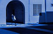 Image of a woman walking in San Diego, California, America west coast by Randy Wells