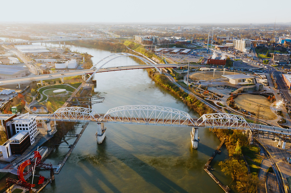 The Cumberland River flowing past Nashville, Tennessee as the sun rises.