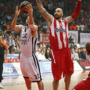 Anadolu Efes's Sinan Guler (L) and Olympiacos's Pero Antic (R) during their Turkish Airlines Euroleague Basketball playoffs Game 5 Olympiacos between Anadolu Efes at SEF Indoor Hall in Piraeus, in Greece, Friday, April 26, 2013. Photo by TURKPIX