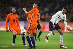England's Dele Alli (right) and Netherlands' Stefan de Vrij (centre)