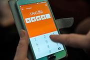 Nederland, Wijchen, 10-2-2020Bankieren met een app van ING bank.Foto: Flip Franssen