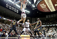 Texas A&M's Alex Caruso (21) dunks the ball as teammate Tavario Miller (42), Missouri's Namon Wright (12) and Kevin Puryear (24) react during the first half of an NCAA college basketball game, Saturday, Jan. 23, 2016, in College Station, Texas.  (AP Photo/Sam Craft)