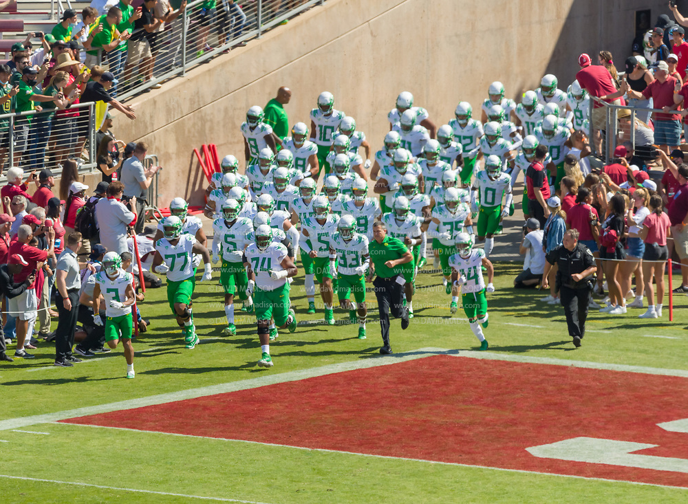 PALO ALTO, CA - OCTOBER 2:  The Oregon Ducks football team led by Head Coach Mario Cristobal (wearing green shirt) enter the field prior to a Pac-12 football game against the Stanford Cardinal on October 2, 2021 at Stanford Stadium in Palo Alto, California.  (Photo by David Madison/Getty Images)