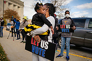 """31 OCTOBER 2020 - DES MOINES, IOWA: People at a """"Unity at the Polls"""" rally across the street from the Polk County Auditor's Office in Des Moines. The rally was to support the right to vote for people of color and people from at risk communities. This is the last weekend of early voting before the 2020 US presidential election. An elections official said that by November 3, which is Election Day, about 45 percent of the registered voters in Polk County will have already voted.     PHOTO BY JACK KURTZ"""