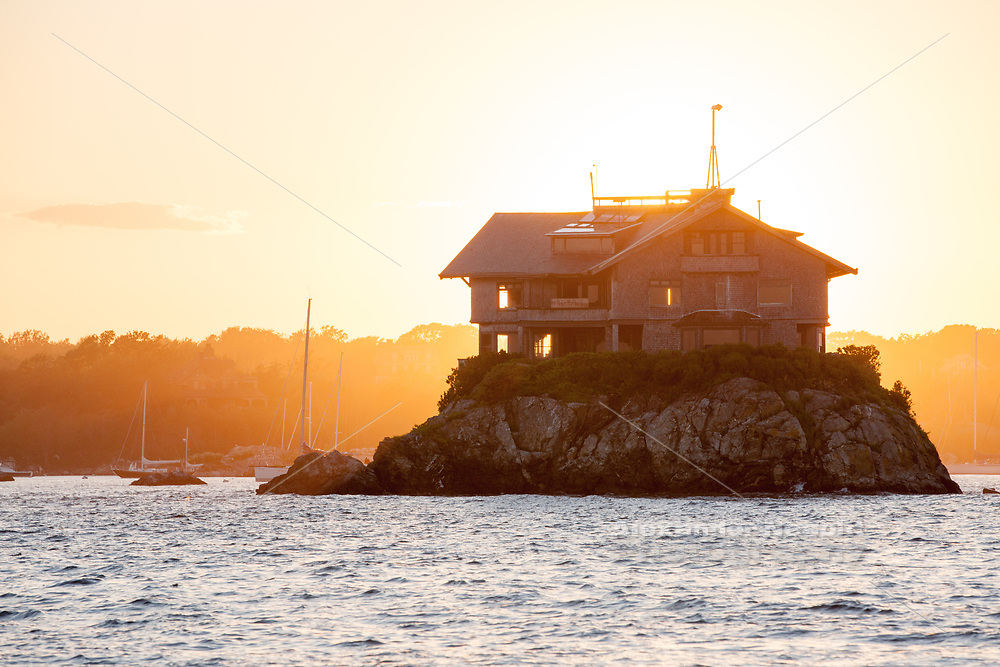 "Built on a rocky outcrop in Narragansett Bay the ""Clingstone"" house is one Of Newport's famous landmarks"