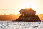 """Built on a rocky outcrop in Narragansett Bay the """"Clingstone"""" house is one Of Newport's famous landmarks"""