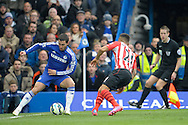 Eden Hazard of Chelsea holding the ball from Ryan Bertrand of Southampton. Barclays Premier league match, Chelsea v Southampton at Stamford Bridge in London on Sunday 15th March 2015.<br /> pic by John Patrick Fletcher, Andrew Orchard sports photography.