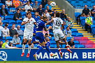 Cardiff City defender Aden Flint  (5) competes for a high ball with Bournemouth forward Jamal Lowe (18) and Morgan Rogers (27) during the EFL Sky Bet Championship match between Cardiff City and Bournemouth at the Cardiff City Stadium, Cardiff, Wales on 18 September 2021.