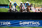 April 29, 2017, 22nd annual Queen's Cup Steeplechase. Jockeys approach a fence during the first race