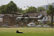An Royal Air Force Puma helicopter takes off after only a few moments on the ground in Ruskin Park, a public space in the south London borough of lambeth. The RAF often land their helicopters here as part of air crew training and familiarisation - rumoured to be part of emergency evacuation/extraction landing locations around the capital. Otherwise, the Puma is used in the battlefield within the Joint Helicopter Command and provide tactical troop and load movement by day or by night.