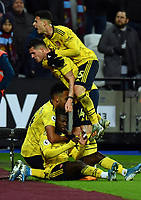 Football - 2019 / 2020 Premier League - West Ham United vs. Arsenal<br /> <br /> Arsenal's Nicolas Pepe (seated) celebrates with team mates after scoring his side's second goal, at The London Stadium.<br /> <br /> COLORSPORT/ASHLEY WESTERN