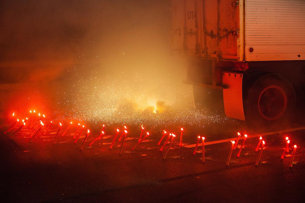 Flares surround a broken-down truck on the George Washington Bridge